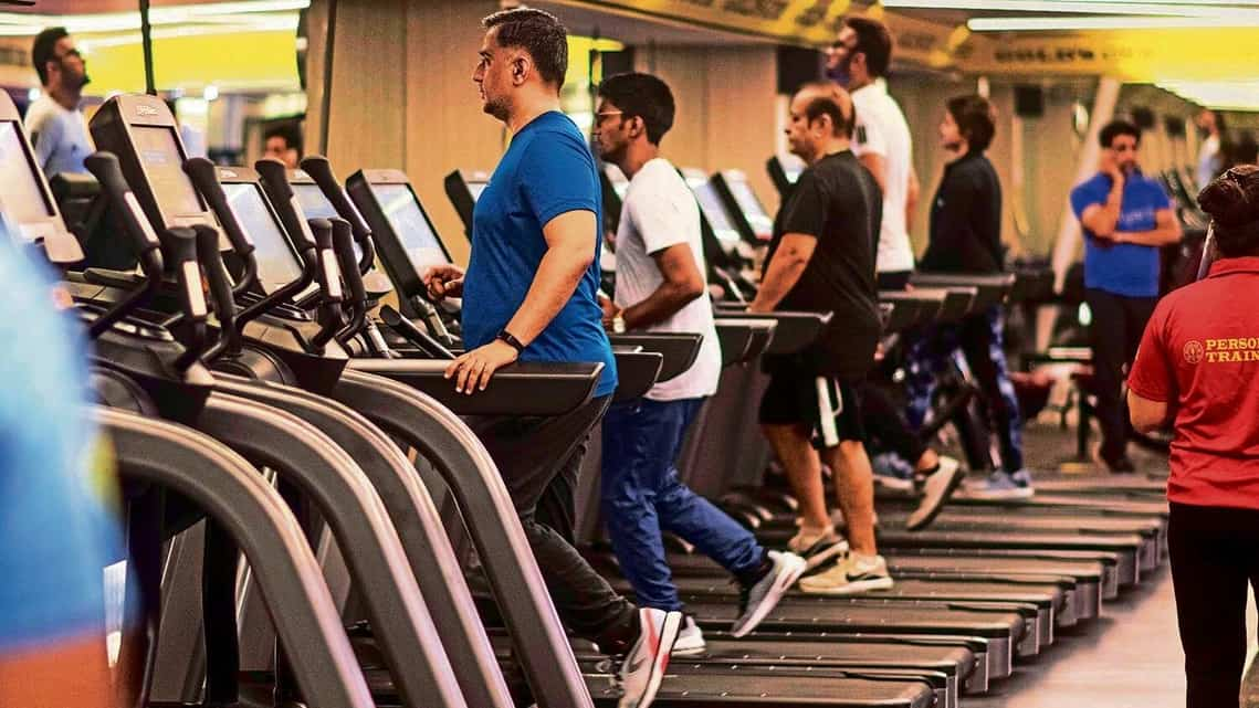 Patrons workout at a gym in Mumbai in October 2020 without wearing face-masks.