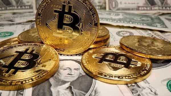 Representations of virtual currency Bitcoin are placed on U.S. Dollar banknotes in this illustration (REUTERS)
