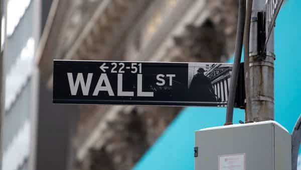 A Wall Street street sign is displayed in front of the New York Stock Exchange (NYSE) (Bloomberg)