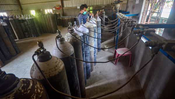 A technician refills medical oxygen cylinders in an industrial facility to supply to hospitals for the treatment of COVID-19 patients. (PTI)