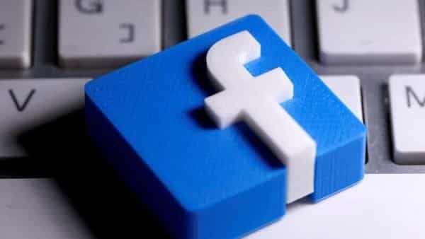 FILE PHOTO: A 3D-printed Facebook logo is seen placed on a keyboard in this illustration taken March 25, 2020 (REUTERS)