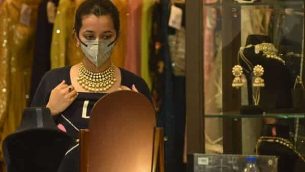 Gold prices in India include 10.75% import duty and 3% GST. (AFP)