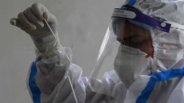 A health worker collects a swab sample for a RT-PCR COVID-19 Coronavirus test at a community centre in New Delhi. (AFP)