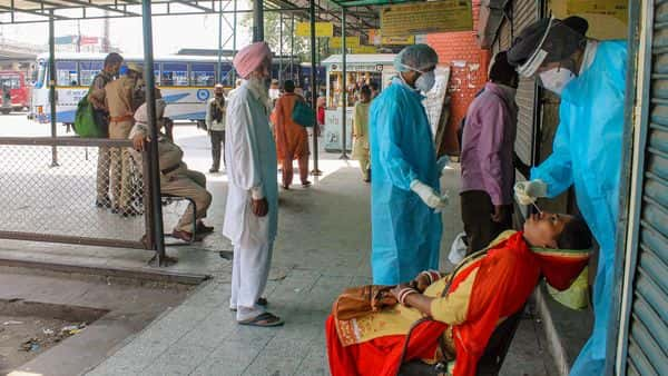 Health workers collect nasal swab samples  (PTI)