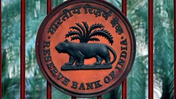 A Reserve Bank of India (RBI) logo is seen at the gate of its office in New Delhi. (REUTERS)