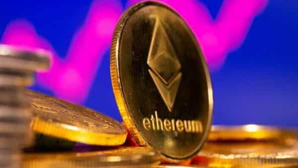 A representation of virtual currency Ethereum are seen in front of a stock graph in this illustration. (REUTERS)