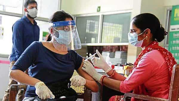 A medico administers a dose of Covid-19 vaccine to a woman during the third phase of inoculation drive in Gurugram