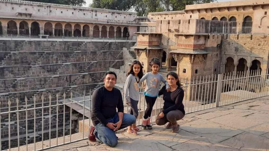 Tarun Kumar Bansal and his wife Sunaina with their daughters Trijaa and Shubhda at Abhaneri Chand Baori, Rajasthan.