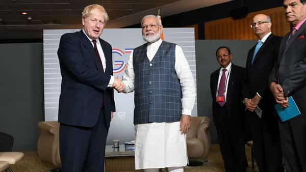 FILE PHOTO: Britain's Prime Minister Boris Johnson meets Indian Prime Minister Narendra Modi at a bilateral meeting during the G7 summit in Biarritz, France August 25, 2019. Stefan Rousseau/Pool via REUTERS/File Photo (REUTERS)