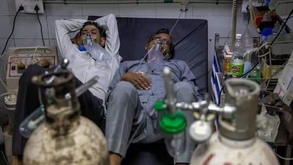 Patients suffering from coronavirus get treatment at the casualty ward in Lok Nayak Jai Prakash (LNJP) hospital. (REUTERS)