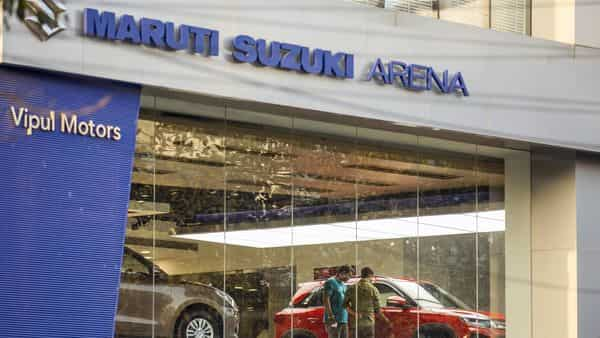 Customer look at a Maruti Suzuki India Ltd. Brezza vehicle at one of the automaker's showrooms in Noida. (Bloomberg)