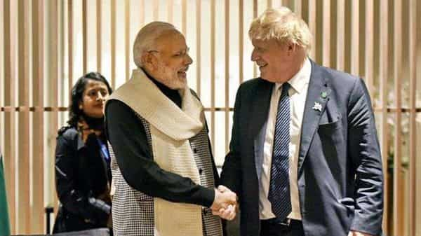 Prime Minister Narendra Modi with Britain Prime Minister Boris Johnson. (File photo) (HT_PRINT)