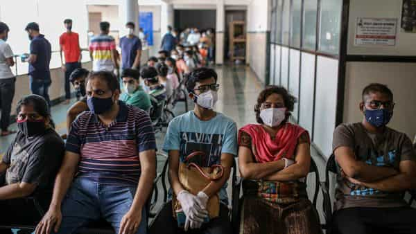Picture for representation. People wait at a Covid-19 vaccination center at a municipal hospital in Pune, Maharashtra, (Bloomberg)