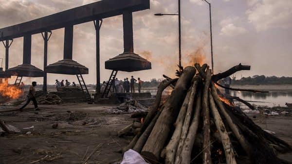 File Photo: Burning pyres of Covid-19 fatalities at a crematorium in Agra, Uttar Pradesh, India, (Bloomberg)