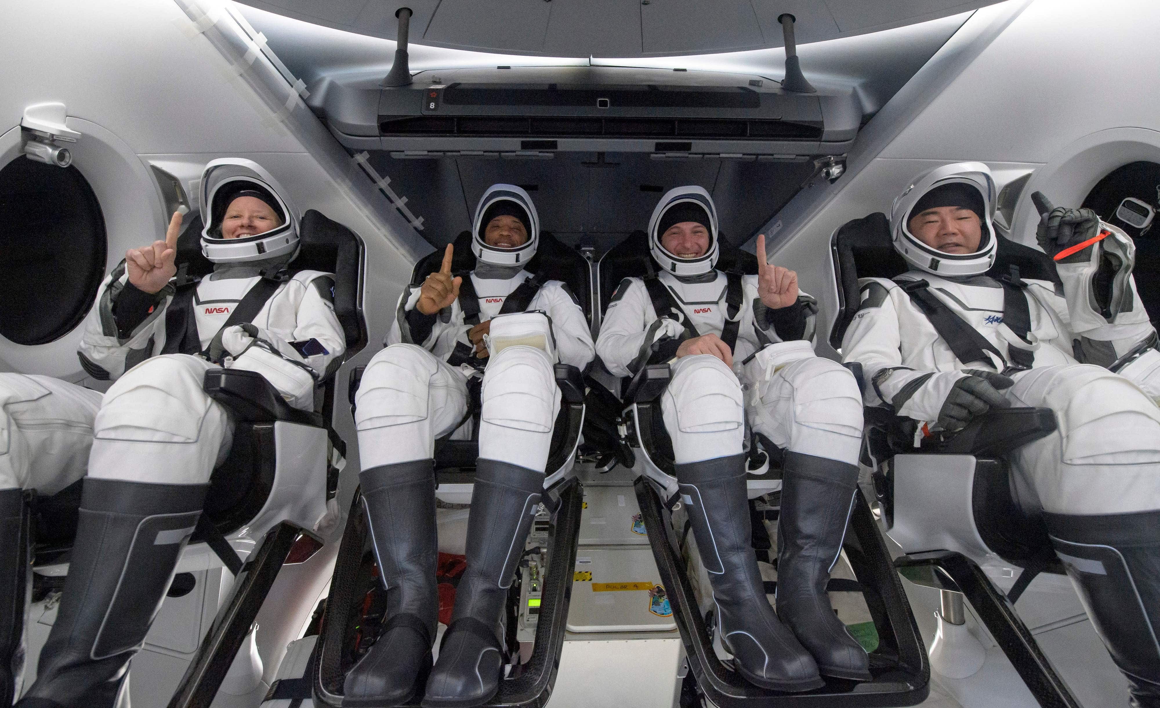 NASA astronauts (from left) Shannon Walker, Victor Glover, Mike Hopkins, and Japan Aerospace Exploration Agency (JAXA) astronaut Soichi Noguchi, inside the SpaceX Crew Dragon Resilience spacecraft onboard the SpaceX GO Navigator recovery ship after landing in the Gulf of Mexico off the coast of Panama City, Florida.