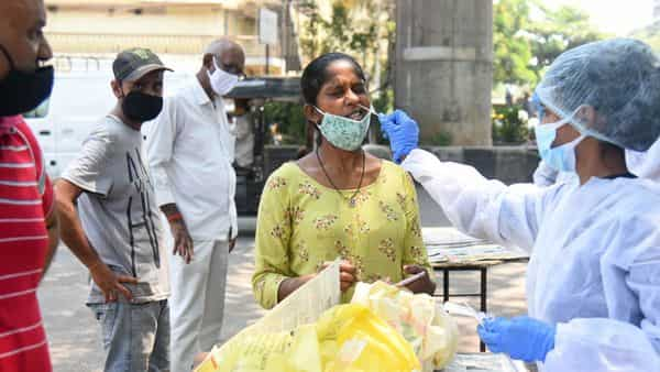 A health worker collects swab samples of citizens for the Covid-19 test (HT PHOTO)