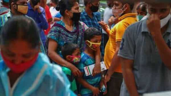 File photo. People wearing masks as a precaution against the coronavirus wait to test for COVID-19 at a government hospital in Hyderabad, (AP)