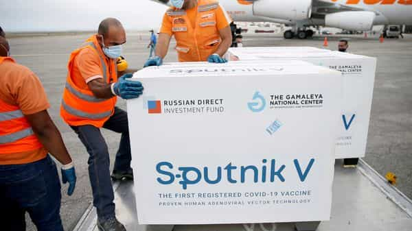 Workers take care of the shipment of Russia's Sputnik V vaccine. (REUTERS)