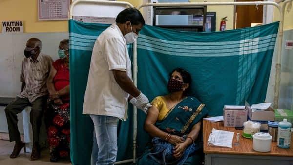 Minakshamma, 68, receives a dose of COVISHIELD, a coronavirus disease (COVID-19) vaccine manufactured by Serum Institute of India, at a vaccination centre in Bengaluru, May 13, 2021. (REUTERS)