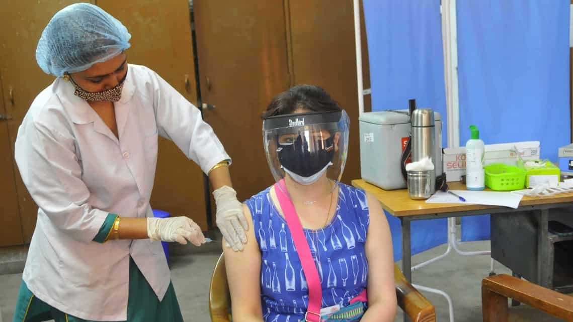 A resident takes her first dose of the covid-19 vaccine at a vaccination centre in Chandigarh.