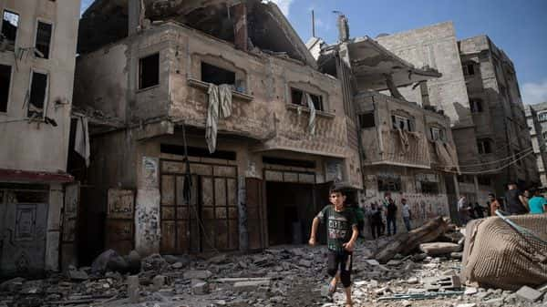 Palestinians inspect damaged houses that were hit in early morning Israeli airstrikes, in Gaza City, Monday, May 17, 2021. (AP)
