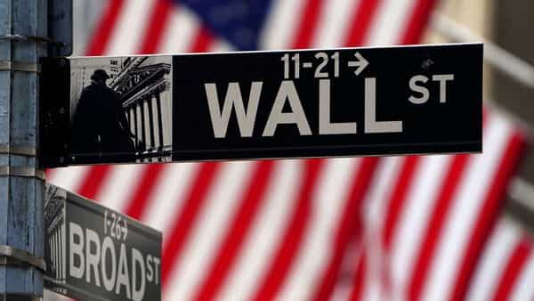 A Wall Street sign is pictured outside the New York Stock Exchange. (REUTERS)