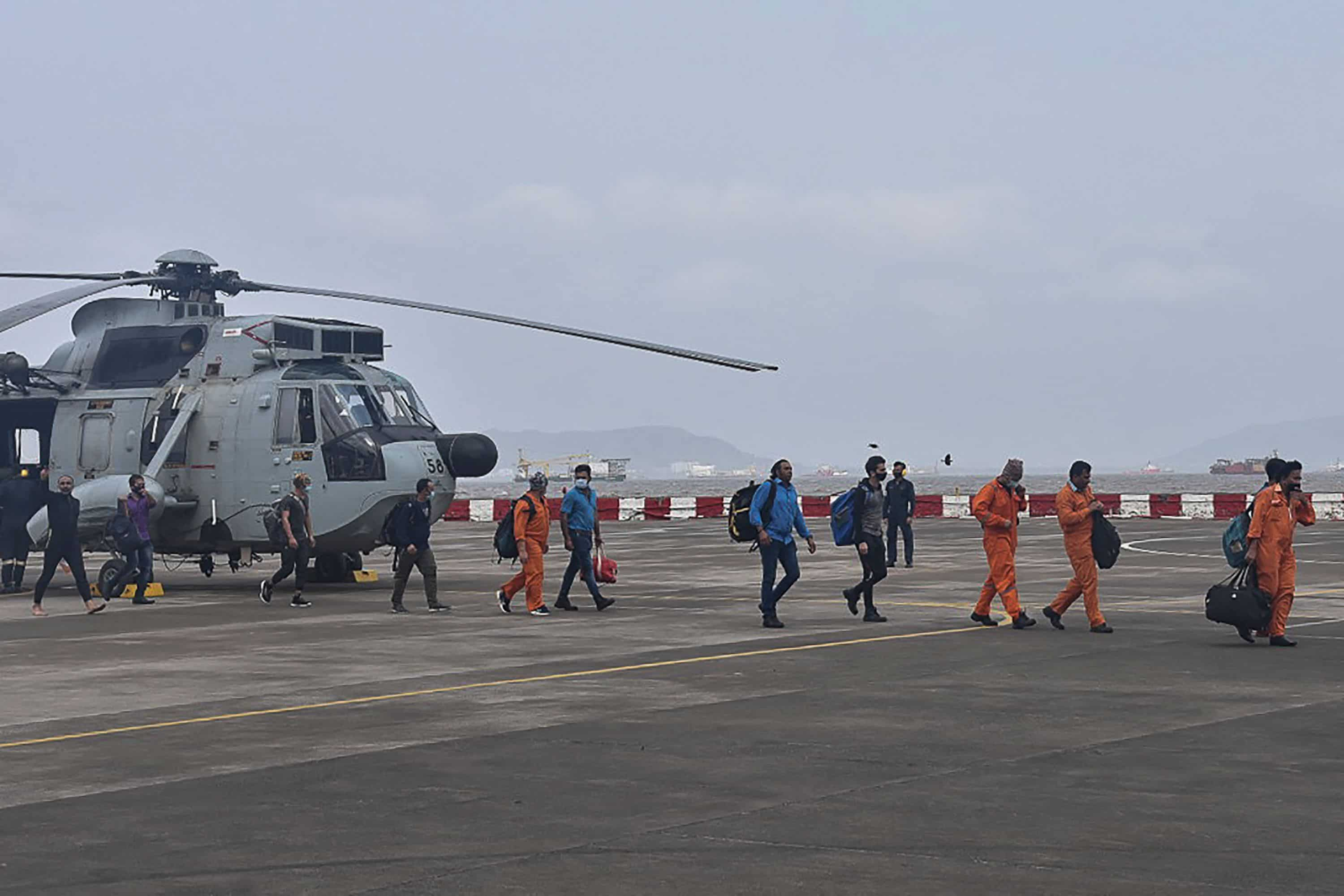 Workers rescued from Barge P305, which had gone adrift amidst heavy rain and strong winds due to Cyclone Tauktae,