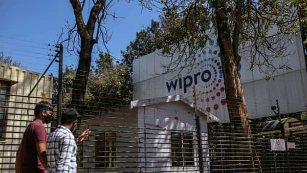 Employees enter a Wipro Ltd. office building in the Electronic City area of Bengaluru. (Bloomberg)