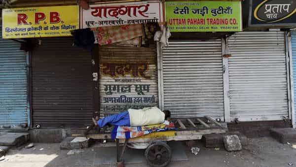 A man sleeps outside a closed shop during Covid-induced lockdown (PTI)