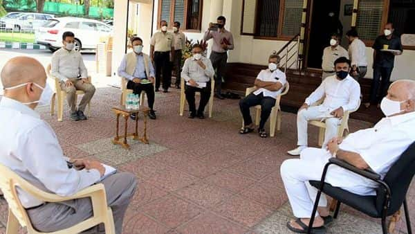 Karnataka Chief Minister BS Yediyurappa holds an emergency meeting regarding the COVID-19 situation with Health Minister Dr. K Sudhakar, Chief Secretary P Ravikumar and others, in Bengaluru on Friday. (ANI Photo)