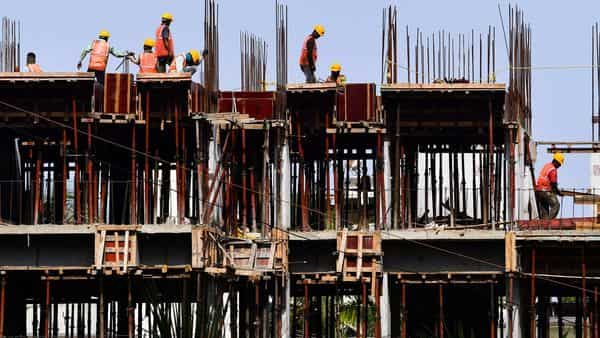 Labourers work at a construction site in Mumbai (AFP)