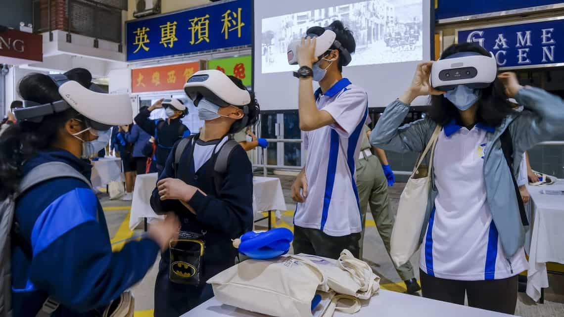 School children try out virtual reality or VR headsets at the tactical training complex during an open day for National Security Education Day at the Hong Kong Police College in Hong Kong, China, on Thursday, April 15, 2021.