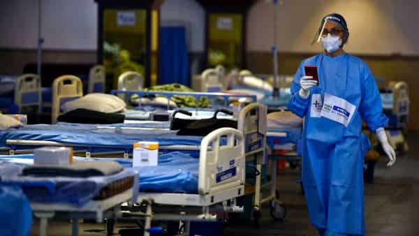 File Photo: A view inside the Covid Care Centre set up at Shehnai Banquet Hall attached to LNJP Hospital, in New Delhi (HT)