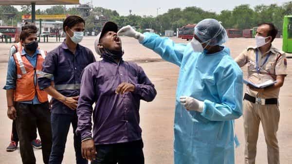 A health worker collects a swab sample for the Covid-19 test (Arvind Yadav/HT PHOTO)