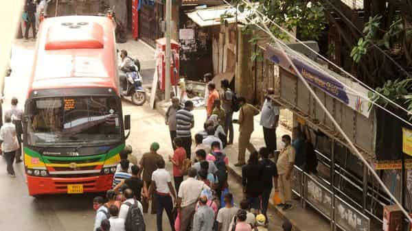 (File photo)  People waiting in queue at a BEST bus stand outside station in Borivali (West), Mumbai (HT PHOTO)