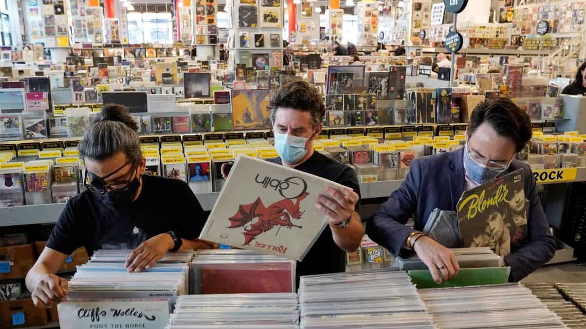 Record shoppers hunt through rare vinyl on the re-opening day of Amoeba Music on Hollywood Blvd., Thursday. Photo via AP