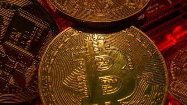 FILE PHOTO: Representations of the virtual currency Bitcoin stand on a motherboard in this picture illustration (REUTERS)