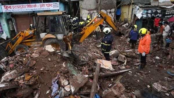 Rescue workers remove debris to search for survivors after a residential building collapsed on top of another building in Mumbai. (REUTERS)
