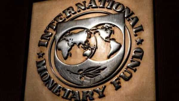The logo of the International Monetary Fund is visible on their building. (AP)