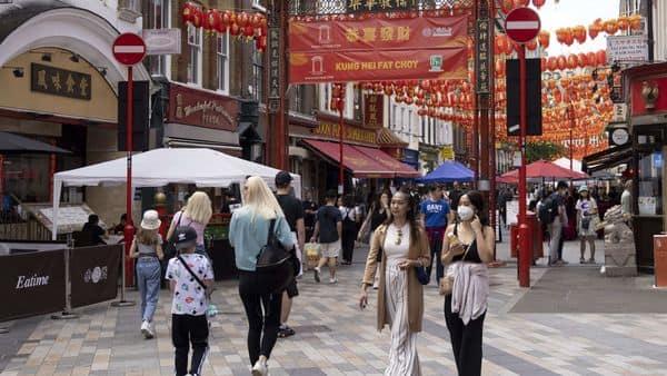 Shoppers walk through Chinatown in London, UK. (Bloomberg)