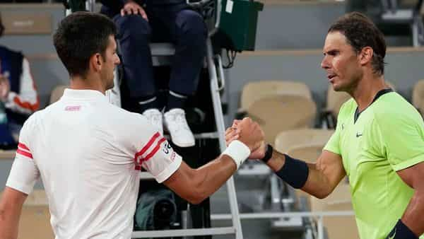 Paris: Serbia's Novak Djokovic, left, shakes hands with Spain's Rafael Nadal after their semifinal match of the French Open tennis tournament at the Roland Garros stadium Friday, June 11, 2021 in Paris. Novak Djokovic won 3-6, 6-3, 7-6 (4), 6-2. AP/PTI(AP06_12_2021_000019B) (AP)