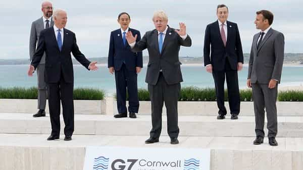 US President Joe Biden and British PM Boris Johnson gesture as they pose for a family photo with G-7 leaders; European Council President Charles Michel, Japan's PM Yoshihide Suga, Italy's Prime Minister Mario Draghi and French President Emmanuel Macron at the G-7 summit, in Carbis Bay, Cornwall, Britain (Photo: Reuters)