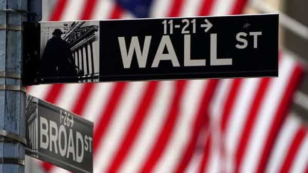FILE PHOTO: A Wall Street sign is pictured outside the New York Stock Exchange amid the coronavirus disease (COVID-19) pandemic in the Manhattan borough of New York City (REUTERS)