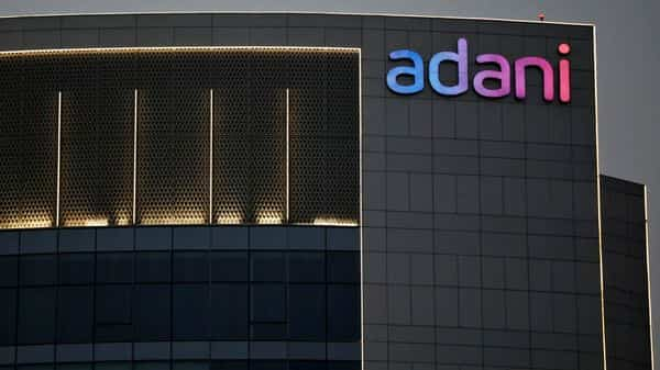 The logo of the Adani Group is seen on the facade of one of its buildings on the outskirts of Ahmedabad. (File photo)