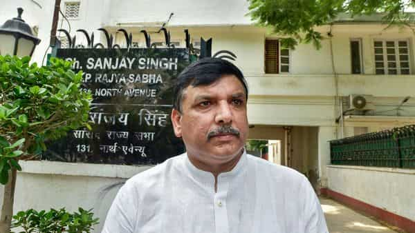 AAP MP Sanjay Singh outside his residence as police said an attempt was made to deface the nameplate, in New Delhi. (PTI)