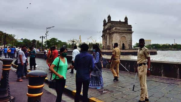 Mumbai police officials evacuate people at Gateway of India after 4 pm as per govt's new lockdown guidelines in the city.