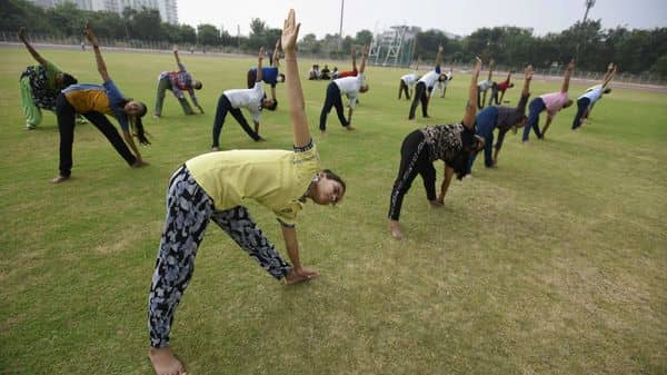 People performing yoga during preparations for the 7th International Yoga Day