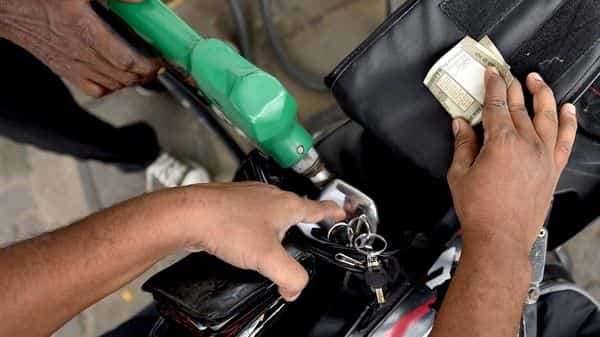 Chennai: An attendant at a fuel station. (PTI)