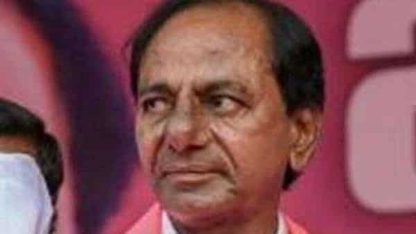 An IAS officer was seen touching the feet of Chief Minister K Chandrasekhar Rao at an official function on Sunday (HT)