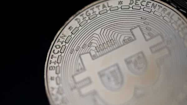 File photo shows a physical imitation of the Bitcoin crypto currency (AFP)